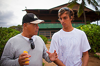 Haleiwa Hawaii,(Thursday November 18, 2010) Ben Aipa (HAW) coaching Alex Smith (HAW)....The Reef Hawaiian Pro was back in action today as an eerie, glowing blanket of cloud crept over the North Shore. Waves were head-high-plus and winds were still light offshore, which encouraging an 8am start to the round of 96. A flood watch has been issued for the islands today through Friday afternoon and light rain began to fall at the end of the Round. ..Surfline.com, official surf forecasters for the Vans Triple Crown of Surfing, expect today's wave heights to gradually diminish with a new swell expected Sunday for the final day of the Reef Hawaiian Pro  the Reef Clash of the Legends..Photo: joliphotos.com