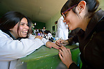 Students work on each other's fingernails in a beautician class at the Instituto de Buena Voluntad (the Good Will Institute) in Montevideo, Uruguay. Sponsored by the Methodist Church of Uruguay, the institute receives financial support from United Methodist Women.