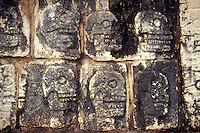 Skull rack or tzompantli on the Platform of the Skulls at the Mayan ruins of Chichen Itza, Yucatan, Mexico