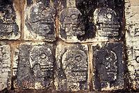 Skull rack or tzompantli on the Platform of the Skulls at the Mayan ruins of Chichen Itza, Yucatan, Mexico
