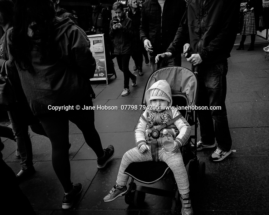 Edinburgh, UK. 15.04.2017. Small child in a pushchair, Royal Mile. Photograph © Jane Hobson.