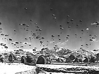 Men and equipment being parachuted to earth in an operation conducted by United Nations airborne units. Ca.  1951. Defense Dept. (USIA)<br /> Exact Date Shot Unknown<br /> NARA FILE #:  306-PS-51-5924<br /> WAR &amp; CONFLICT BOOK #:  1429