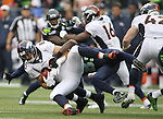 Seattle Seahawks kickoff coverage specialists Ricardo Lockett (83) brings down Denver Broncos James Casey (80) during the first quarter at CenturyLink Field on August 14, 2015 in Seattle Washington.  The Broncos beat the Seahawks 22-20.  © 2015. Jim Bryant Photo. All Rights Reserved.