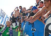 Jon Busch celebrates with fans. The San Jose Earthquakes defeated the LA Galaxy 1-0 at Buck Shaw Stadium in Santa Clara, California on August 21st, 2010.