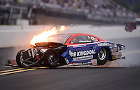 Sept. 16, 2012; Concord, NC, USA: NHRA pro stock driver Shane Gray on fire as he crashes during the O'Reilly Auto Parts Nationals at zMax Dragway. Gray would be uninjured. Mandatory Credit: Mark J. Rebilas-