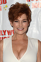 """HOLLYWOOD, CA - AUGUST 18:  Carolyn Hennesy at """"Child Stars - Then and Now"""" Exhibit Opening at the Hollywood Museum on August 18, 2016 in Hollywood, California. Credit: David Edwards/MediaPunch"""