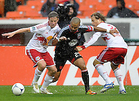 D.C. United forward Maicon Santos (29) goes against New York Red Bulls defender Jan Gunnar Solli (8) left and defender Stephen Keel (22) right.  D.C. United defeated The New York Red Bulls 4-1 at RFK Stadium, Sunday April 22, 2012.