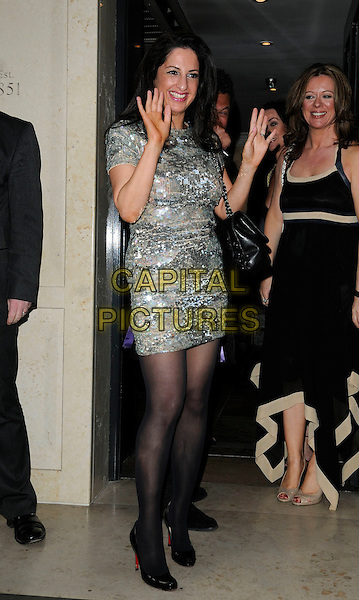LISA BYRNE .At the OK! Magazine's Editor in Chief Lisa Byrne's 40th Birthday Party, Flemings Mayfair Hotel, London, England, UK, April 20th 2010..full length gold silver dress black tights hands shoes metallic shiny waving sequined sequin .CAP/CAN.©Can Nguyen/Capital Pictures.