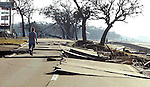 A Biloxi, Mississippi residents walk down US 90 after Hurricane Katrina devistated this Gulp coast community August 29, 2005.  The tropical cyclone cause catastrophic damage in Biloxi along the Mississippi Gulf coast.