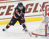 Claire Santostefano (NU - 13) - The Northeastern University Huskies tied Boston University Terriers 3-3 in the 2011 Beanpot consolation game on Tuesday, February 15, 2011, at Conte Forum in Chestnut Hill, Massachusetts.