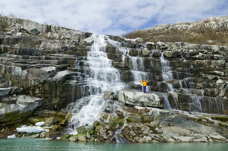 Hiker at waterfall, Nellie Juan Lagoon, Prince William Sound, Alaska