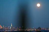 The Blue moon rises next to the Empire State Building and middle Manhattan while it is seen from New Jersey.  07/31/2015. Eduardo MunozAlvarez/VIEWpress