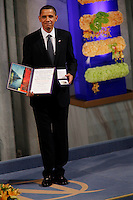 (Dec 10,2009 Oslo,Norway) US President Barack Obama received the Nobel Peace Prize during a ceremony in Oslo Town Hall. The prize was given to Obama by Nobel committee leader Thorbjørn Jagland. .©Fredrik Naumann/Felix Features.
