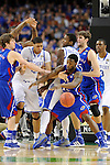 2 APR 2012: Guard Tyshawn Taylor (10) from the University of Kansas battles for a loose ball against forward Anthony Davis (23) from the University of Kentucky during the Championship Game of the 2012 NCAA Men's Division I Basketball Championship Final Four held at the Mercedes-Benz Superdome hosted by Tulane University in New Orleans, LA. Kentucky defeated Kansas 67-59 to claim the championship title. Ryan McKeee/ NCAA Photos.