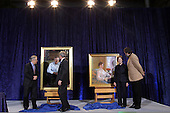 Washington, DC - December 19, 2008 -- United States President George W. Bush, right, with artist Robert Anderson, left, with Laura Bush after the unveiling of his portrait at the National Portrait Gallery in Washington, D.C. on Friday, December 19, 2008.  .Credit: Ken Cedeno / Pool via CNP