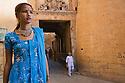 Rajasthani girl near entrance gate of Jaisalmer Fort in blue saree, Jaisalmer, Rajasthan, India --- Model Released