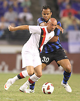 Amantino Mancini #30 of Inter Milan tangles with Stephen Ireland #7 of Manchester City during an international friendly match on July 31 2010 at M&T Bank Stadium in Baltimore, Maryland. Milan won 3-0.