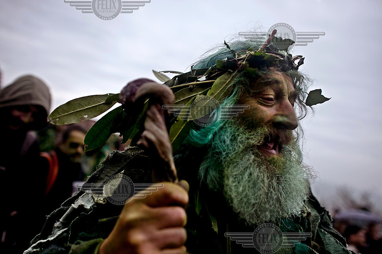 A participant at the 'Jack in the Green' festival in Hastings. The festival is part of a recent revival of an older custom where people would wear frameworks covering much of their bodies which were decked out in foliage. The custom is connected to English May Day parades that herald  the coming of summer.