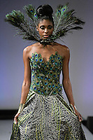 Model walks runway in an outfit from the BlacMéra collection by Yuliana Candra, during Couture Fashion Week New York Fall 2012.