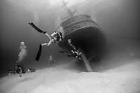 10 June 2014: SCUBA Instructor Ragime Powery approaches the USS Kittiwake, a former United States Navy submarine rescue vessel, off Seven Mile Beach, on the West Shore of Grand Cayman Island. Purchased by the government of the Cayman Islands, the Kittiwake was intentionally sunk on January 5, 2011, to create an artificial reef in the Cayman Marine Park. Located in the British West Indies in the Caribbean, the Cayman Islands are renowned for excellent scuba diving, snorkeling, beaches and banking.  Mandatory Credit: Ed Wolfstein Photo *** RAW (NEF) Image File Available ***