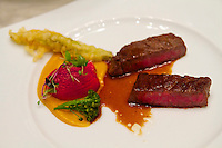 "Singapore. Marina Bay Sands. Sky on 57 showcases a modern twist of Franco Asian Cuisine in a setting that offers a birds eye view of Singapore and the bay..M7 Wagyu Beef ""Kobe cuisine"".Glazed with Asian pepper sauce and summer vegetables"