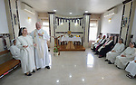 Cardinal Timothy Dolan, the archbishop of New York, delivers a homily during Mass at the convent of the Dominican Sisters of St. Catherine of Siena Ankawa, near Erbil, Iraq, on April 9, 2016.  Sister Luma Khudher translates his words into Arabic.<br /> <br /> Dolan, chair of the Catholic Near East Welfare Association, was in Iraqi Kurdistan with other church leaders to visit with Christians and others displaced by ISIS. The Dominican Sisters were themselves displaced by ISIS, and have established schools and other ministries among the displaced.