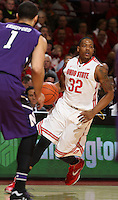 Ohio State Buckeyes guard Lenzelle Smith Jr. (32) avoids Northwestern Wildcats guard/forward Drew Crawford (1) in the first half of their game against the Northwestern Wildcats at the Value City Arena in Columbus, Ohio on February 19, 2014. (Columbus Dispatch photo by Brooke LaValley)