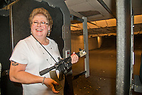 Lorton,VA, July 10 2016, USA--Rita Mayer, a transgender woman shows off her AK 15 pistol at a gun range in Lorton, VA.  Members of the Pink Pistols, a Lesbian,Gay, Bi-sexual, Transgender (LGBT) gun club, gather at a shooting range to practice their skills.  The Pink Pistols advocate the rights of all LGBT people to own guns.  Patsy Lynch/MediaPunch