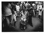 Cross-dresser vendor in Quiapo Market.  Quiapo Church is Manila's biggest Catholic Church.