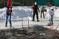 Moscow, Russia, 08/03/2010..Men of the Moscow Ice Swimming Club clear ice from a north Moscow lake before the club's annual end of season Women's Day party..