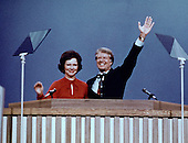 Governor Jimmy Carter (Democrat of Georgia), the 1976 Democratic Party nominee for President of the United States, right, and his wife Rosalynn Carter, left, acknowledge the cheers of the delegates following their acceptance speeches at the 1976 Democratic Convention  at Madison Square Garden, New York, New York on July 15, 1976.<br /> Credit: Arnie Sachs / CNP