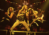 IRON MAIDEN - L-R: Dave Murray, Bruce Dickinson, Steve Harris, Adrian Smith - performing live on the first leg of the World Slavery Tour in UK & Europe - 09 Aug - 14 Nov 1984.  Photo credit: George Bodnar Archive/IconicPix
