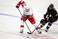 03/02/11 Anaheim, CA: Detroit Red Wings left wing Drew Miller #20 and Anaheim Ducks defenseman Andreas Lilja #3 during an NHL game between the Detroit Red Wings and the Anaheim Ducks at the Honda Center. The Ducks defeated the Red Wings 2-1 in OT.