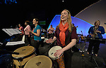 The Assembly Band leads singing during an April 27, 2014, worship service at the United Methodist Women's Assembly in the Kentucky International Convention Center in Louisville, Kentucky. Playing the drums is Rebecca Garrett, the director of music ministries at First United Methodist Church in Gainesville, Texas.