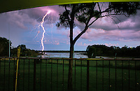 Evening brings lighting over the local social club in Kakadu National Park. Humidity and sweltering heat are broken by the first of the storms.