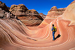 Hiker at The Wave in the Coyote Buttes, Paria Canyon-Vermilion Cliffs Wilderness, Arizona USA