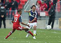 14 April 2012: Chivas USA defender Ante Jazic #13 and Toronto FC midfielder Reggie Lambe #19 in action during a game between Chivas USA and Toronto FC at BMO Field in Toronto..Chivas USA won 1-0.