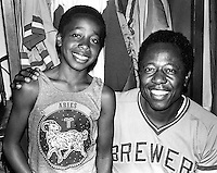 "Slugger Hank Aaron with young Stanley Burrell A's clubhouse boy...who the A's named ""hammer"" because he resemblence to Aaron. Burrell when on to become the rapper M.C. Hammer.(photo copyright 1975 Ron Riesterer)"