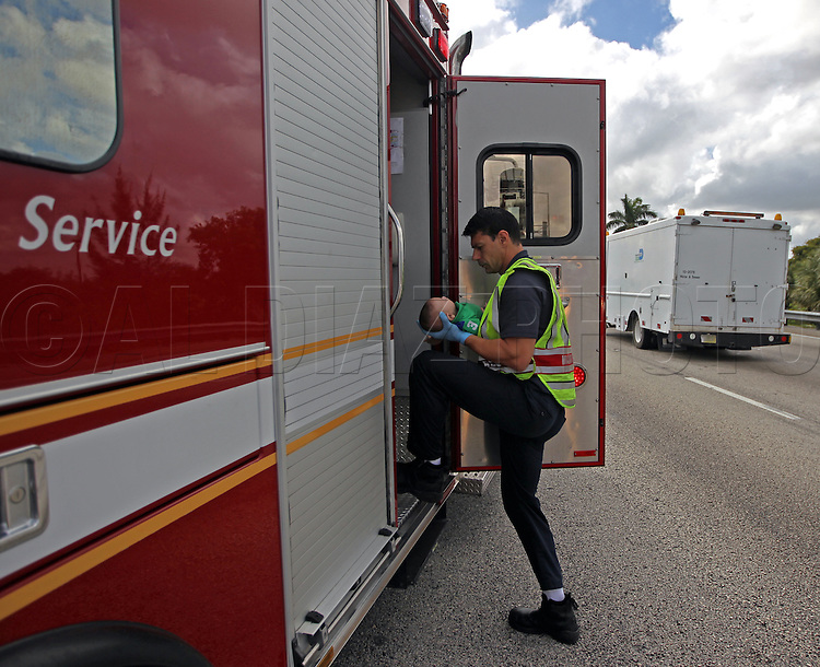 Miami Fire Rescue paramedic transports to the hospital five-month-old Sebastian de la Cruz who stopped breathing.The baby's aunt performed CPR after pulling her SUV over on the side of the road along the west bound lane on Florida state road 836 just east of 57th Avenue around 2:30pm on Thursday, February 20, 2014.