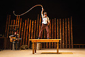 London, UK. 11.07.2013. Southbank Centre presents TIMBER! by Cirque Alfonse. Three generations of Quebecois circus family premiere their UK debut show. Picture shows: Julie Carabinier-Lepine, with whip, and David Simard (on guitar). Photograph © Jane Hobson.