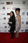 Karmyn Caraballo and LIa Mira Attend Edwing D'Angelo Spring Summer 2014 Presentation Held at Studio 450, NY