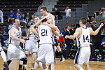 24 MAR 2012:  Western Washington University players celebrate as the game ends against the University of Montevallo during the Division II Men's Basketball Championship held at the Bank of Kentucky Center in Highland Heights, KY. Western Washington won the title 72-65.  Joe Robbins/NCAA Photos