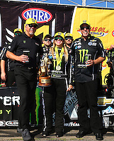 Aug 21, 2016; Brainerd, MN, USA; NHRA top fuel driver Brittany Force (center) celebrates with crew chief Brian Husen (right) and tuner Alan Johnson after winning the Lucas Oil Nationals at Brainerd International Raceway. Mandatory Credit: Mark J. Rebilas-USA TODAY Sports