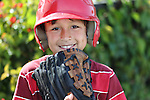Young baseball boy with red helmet