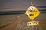 Rural Road sign, clouds, dirt road, Denio, Oregon.
