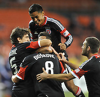 D.C. United defender Dejan Jakovic (8) celebrates his score in the 64th minute of the game with teammates.  D.C. United defeated Chivas USA 1-0 at RFK Stadium, Sunday September 23, 2012.