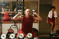 12 October 2005: Kristen Newlin working out in the weight room in Maples Pavilion in Stanford, CA.