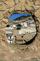 Tunisia, Le Kef.  View of the town through a viewing portal in the wall of the citadel.