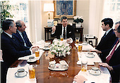 United States President Ronald Reagan holds a luncheon meeting with U.S. arms control negotiators today in the private study beside the Oval Office.  Seated, from left, are: Ambassador Maynard Glitman, Ambassador Max Kampelman, President Reagan, Ambassador Ronald Lehman, and Chief of Staff Howard Baker..Mandatory Credit: Mary Anne Fackelman-Miner - White House via CNP