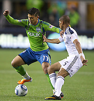 Seattle Sounders FC forward Fredy Montero tries to get around Los Angeles Galaxy defender Sean Franklin during play at Qwest Field in Seattle Tuesday March 15, 2011. The Galaxy won the game 1-0.